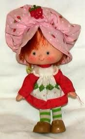 Strawberry shortcake dolls - I have the exact same one! Plus about 10 of her friends on my bookshelf.