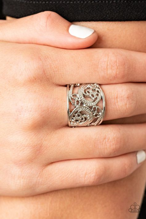Featuring a shiny silver finish, smooth and dotted filigree patterns whirl and swirl across the finger for a whimsical fashion. Features a stretchy band for a flexible fit. Sold as one individual ring.