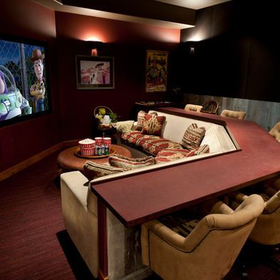 Awesome idea! Bar surrounding thr couch for the basement!