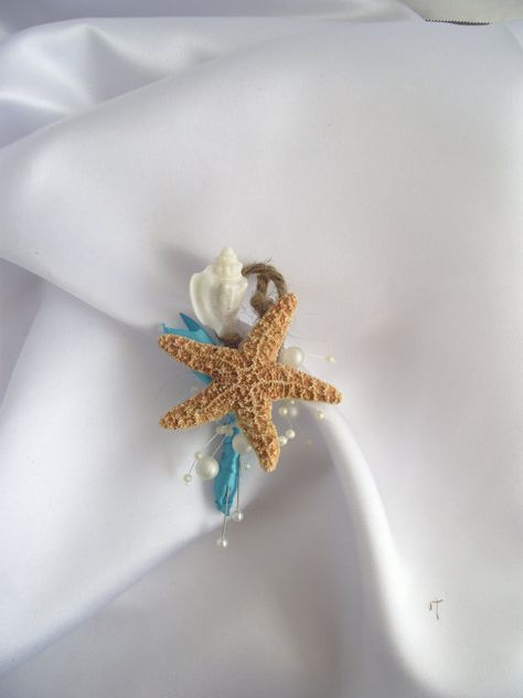 Perfect for a beach or destination wedding or event, I have combined a sugar starfish with a conch shell, ivory pearls, covered the stem in a deep