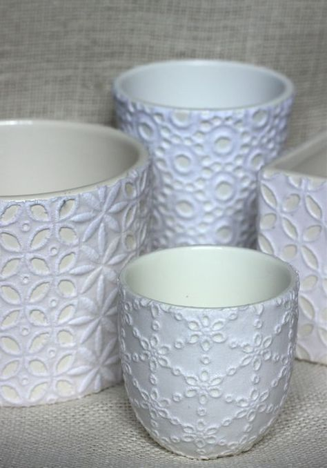 Decoupaging with Lace. White pots and Mod Podge in Matte finish.