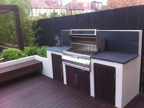 Garden in West London by Paul Newman Landscapes Decking