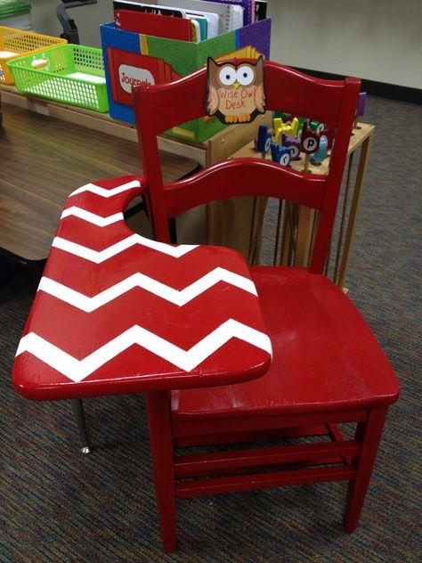 Old school desk painted red with white chevron stripes.