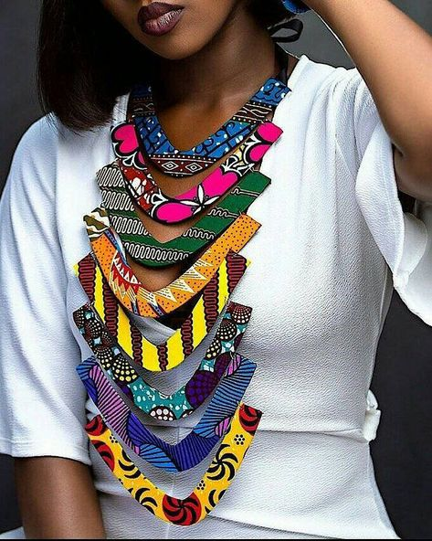Make a grand entrance with this 8 step tiered Ankara statement piece. Each neckpiece is made out of various ankara prints and each is unique.