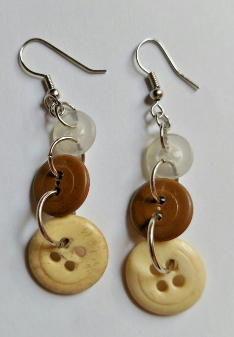 These sweet button earrings feature three vintage buttons in a neutral colorway to compliment any casual or sport attire. They dangle from silver French style ear wires. Button Bracelet, Button Earrings, Diy Earrings, Diamond Earrings, Button Jewellery, Diamond Studs, Wire Jewelry, Jewelry Crafts, Beaded Jewelry