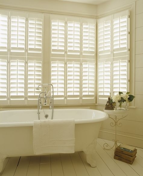 cafe shutters from the New England Shutter Company - these would look great....