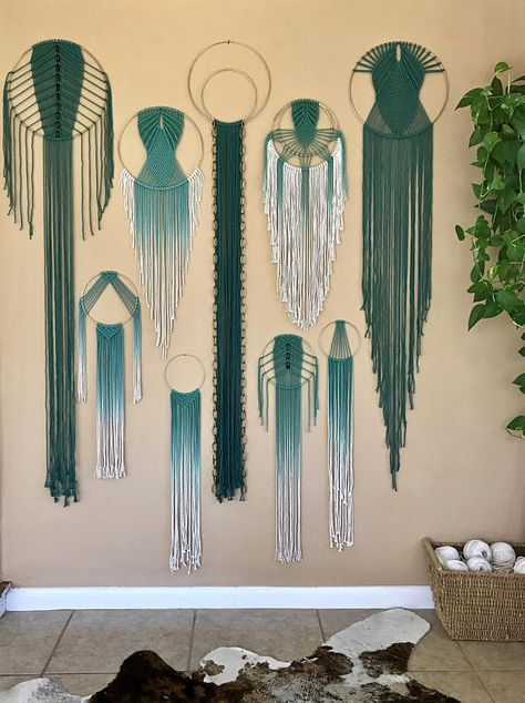 Dreamy handmade macrame wall hanging, made from hand dyed teal cotton rope and a 14 brass ring. Features an intricate modern design and extra long fringe. Would make a lovely gift! Measures approx. 14 wide and 66 long. This piece is ONE OF A KIND and READY TO SHIP! ✦ Shop NEW Teal