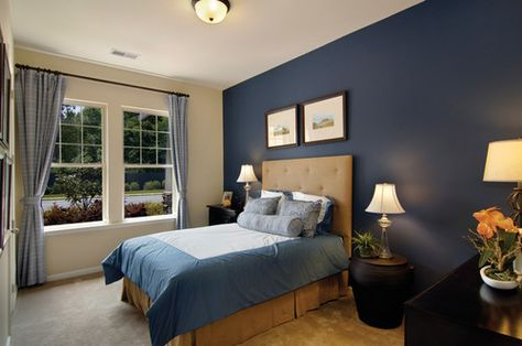 Great secondary bedroom in The Seagrass model in Hilton Head, South Carolina. Love the navy choice for the accent wall!
