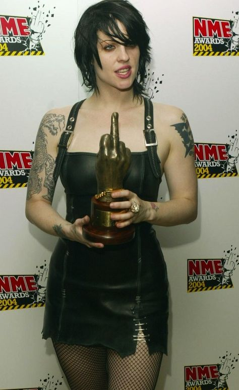 Too hardcore for me, and she really should class up her act. But no argument: Brody Dalle IS beautiful