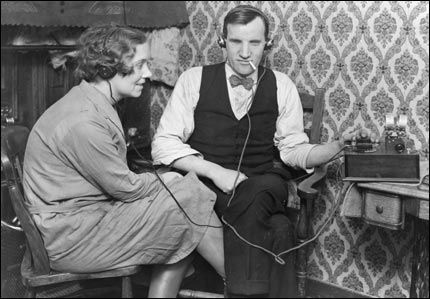 """From the BBC Image Library: """"Blind listener, Mr Oransby [right], listening  to his Crystal Radio Set with headphones, December 1929"""""""