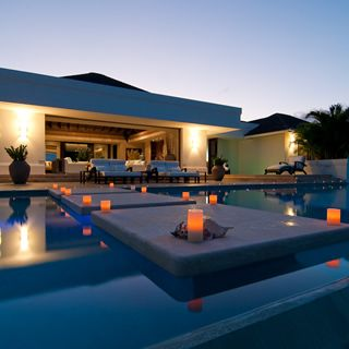 Sleek contemporary design with traditional Caribbean design touches in this  luxury homes for sale in Montego
