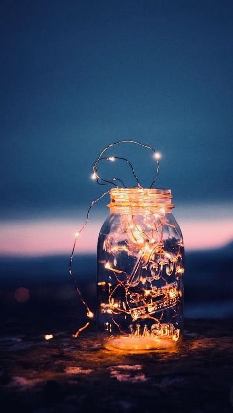 This mason jar filled with our Glow Copper String Lights would make an spectacular centerpiece for your Holiday's dinners and celebrations | Find them at Forest Homes #homedecor #natureinspired #holidaydecor #christmasdecor