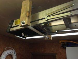 Hanging A Ladder From The Ceiling Ladder Storage Garage Storage Organizational Hacks