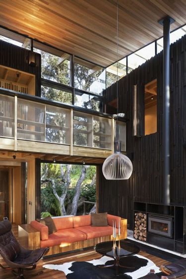 natural wood interiors living room loft balcony vertical dark wood wall light wood ceiling wood couch sofa large glass windows modern - Dark Wood House Interior
