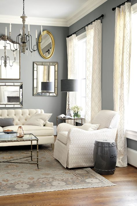 Lighter curtains with darker wall color and wood floor. How to hang drapery Ballard Designs