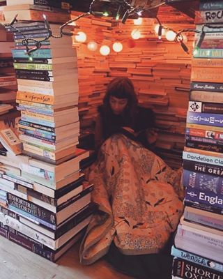 Or maybe your little sanctuary is LITERALLY MADE OUT OF BOOKS.   Show Us A Picture Of Your Awesome Book Nook!