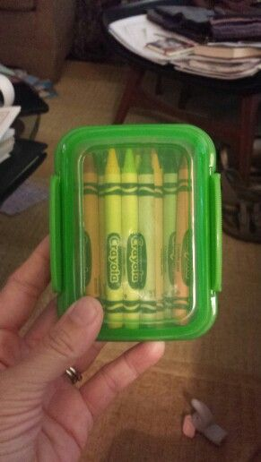 They have these snack containers 2 for a dollar at the dollar tree right now. Holds a whole 24 pack of crayons. They have green, blue, and red.