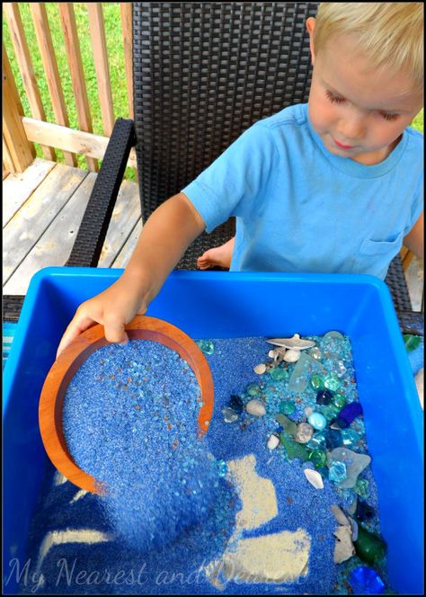 Ocean sensory bin with mirrors at the bottom - fun kids sensory activity