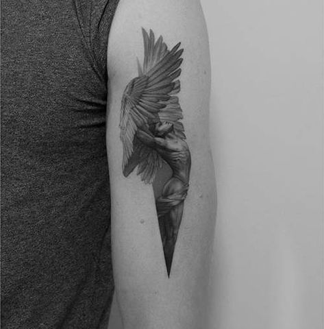 Icarus tattoo on the left bicep.