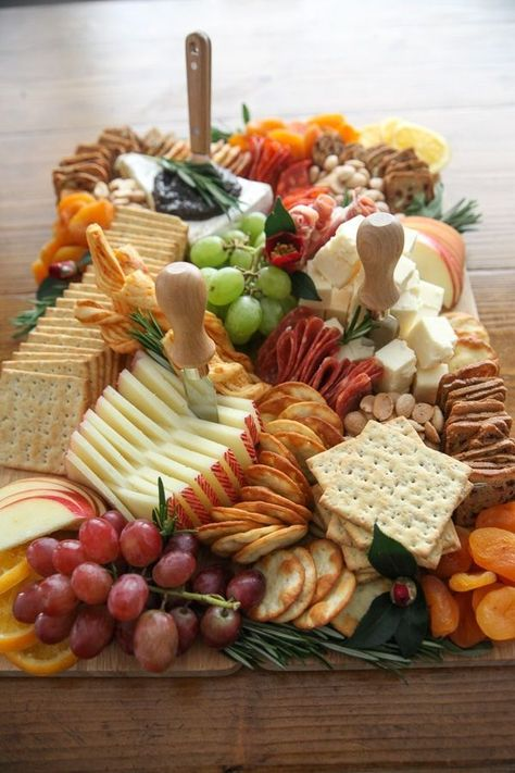 This Thanksgiving Charcuterie Board how-to has everything you need to create a professional cheese board in your home for just 60 Charcuterie Recipes, Charcuterie And Cheese Board, Charcuterie Platter, Cheese Boards, Cheese Board Display, Party Food Platters, Cheese Platters, Party Food Buffet, Cheese Platter Board