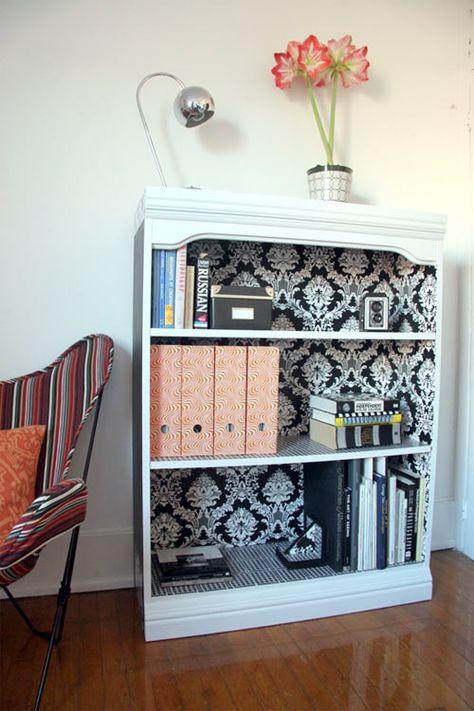 Wallpaper the inside of a bookshelf. what a great idea!