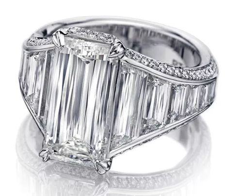 Christopher Design Crisscut emerald diamond engagement ring boasts a crisscut emerald diamond center that clocks in at just over 3 cts. and a platinum design not unlike the custom sparkler worn by Angelina Jolie.