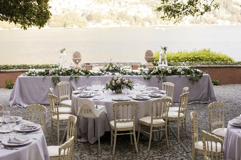 Romantic wedding reception at lake Como, with a bucolic flower arrangement in pink and lavender. #wedding #weddingplanner #weddinginitlay #lakecomo #lakecomowedding #lakecomoweddingplanner #destinationweddinginitaly #weddingdinner #weddingreception #elegantwedding #romanticwedding #weddingflowers #flowerarrangement #flowercenterpiece #weddingcenterpiece #weddingday #weddinfdesign #weddinginspiration #weddingdecor #lavender #pink #white #greenery #greenerygarland #flowergarland