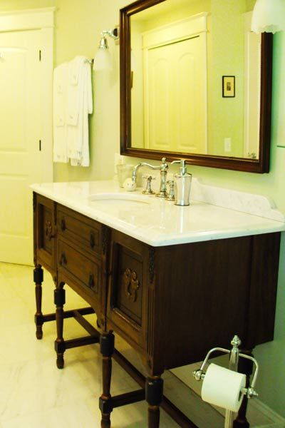 """This was a powder room before, but we gutted it and extended our 1913 house to accommodate a larger bathroom. We bought the vanity for the sink at a consignment shop, cut the top off and replaced it with marble to match the rest of the room. It saved us hundreds not having to buy the 'perfect' vanity with the right stone on it."" -TOH reader Sarah S."