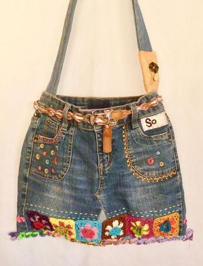 In its previous life, this colorfully fun bag consisted of a pair of girls denim jeans, girls dress (bag lining), vintage obi, crocheted granny squares, belt, various trim, beads, Chinese coin, and fabric scraps. All of these items have come together, and been repurposed in its current incarnation