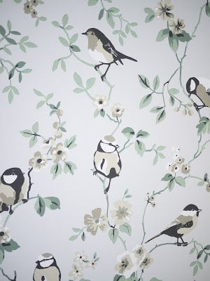 Bird, branch, and blossoms. Delicate look, particularly for a small powder or laundry room.