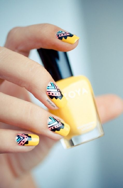 Tribal inspired yellow nail art design. The yellow color is prevalent in this design as it also sports a multi colored tribal design on the cuticle part of the nails.