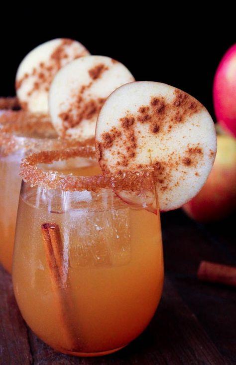 Spiced Cider Margaritas 5 ounces spiced apple cider ½ teaspoon lemon juice .5 ounces Grand Marnier (or Cointreau) 1.5 ounces mescal or gold tequila For garnish: (optional) 2 tablespoons raw sugar 1/8 teaspoon ground cinnamon Cinnamon sticks Apple slices