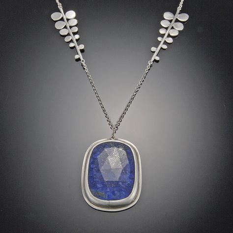 Lapis Necklace on Fern Chain by Ananda Khalsa. This vibrant rose cut lapis necklace is accented with fern stations set in a sterling silver chain. Pendant measures approximately inches. Each stone is unique and may vary from the photo.