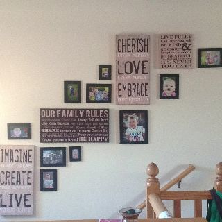 Family pictures wall collage decor. Like the canvas!  I would do bigger pics with this for my hallway.