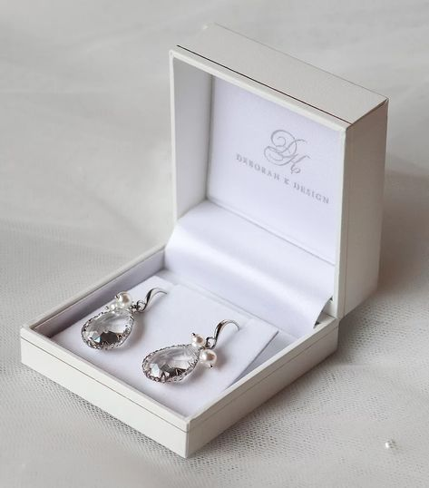 Our Blanca PearlSilver Earrings have a large crystal dropper with two delicate Swarovski Pearls added for a touch of sophistication and elegance to your bridal look. These would look amazing on both brides and bridesmaids. Visit www.deborahkdesign.co.uk to view our Bridal Accessories Collections. #silverearrings #crystalearrings #bridalearrings #weddingearrings #bridesmaidearrings