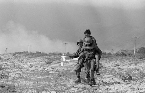 VIETNAM - Vietnam marks 50 years since launch of Tet Offensive - January A wounded South Vietnamese soldier is helped by comrades in Danang, during the Tet Offensive in during the Vietnam war
