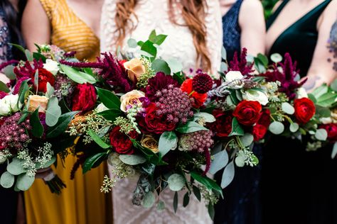 Bride and bridesmaids jewel-toned bouquets for fall Chicago wedding at The Joinery