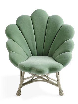 Shell like upholstered Venus Chair.