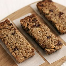Homemade granola bars loaded with oats, wheat germ, peanut butter, swirled peanut butter chocolate chips, and peanuts.