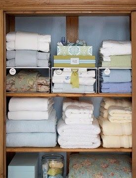 Contain sheet sets by wrapping the pillowcases around the flat and fitted sheets, or secure with a wide, decorative ribbon. Organize bedding and towels by size and color to keep your linen closet looking neat and pretty. | http://www.abhomeinteriors.com/blog/2012/09/5-ways-to-dress-up-your-linen-closet