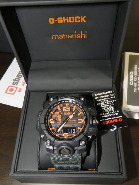 "Maharishi x G-Shock Mudmaster that features a fully customized ""British Bonsai Forest"" design, black bezel and buttons, an orange index with orange-lined hands, a camouflage pattern on the bands, and a Maharishi engraved logo on the stainles Casio G Shock Watches, Sport Watches, Casio Watch, Stylish Watches, Luxury Watches For Men, Cool Watches, Men's Watches, G Shock Mudmaster, G Shock Men"