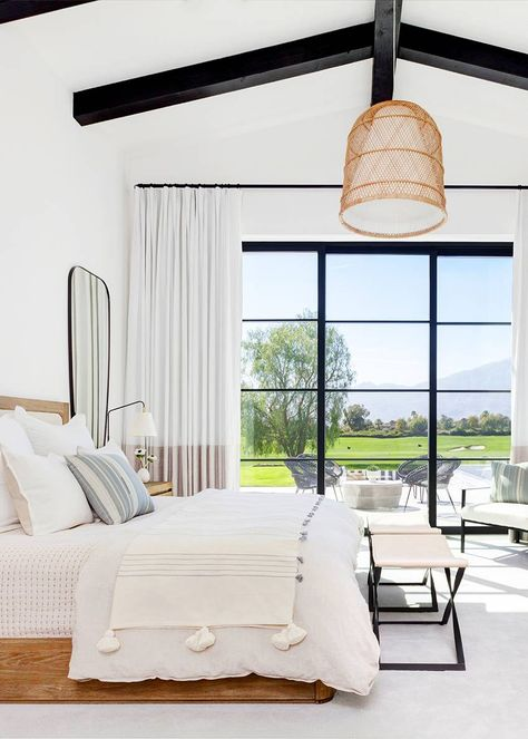 Serene master bedroom with wall of window. Inside a Modern Family Home in La Quinta, California | MyDomaine