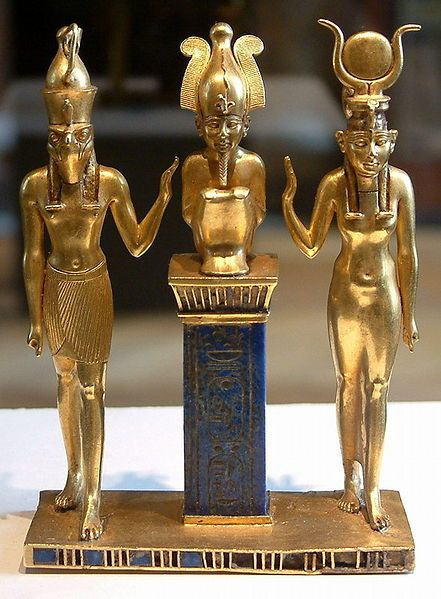 The family of Osiris. Osiris on a lapis lazuli pillar in the middle, flanked by Horus on the left and Isis on the right (Louvre, Paris)