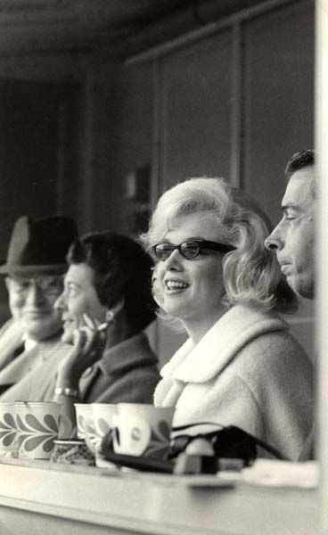 Marilyn Monroe & Joe DiMaggio, at a Yankee game.