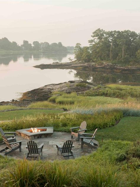 A circular stone patio overlooks Long Island Sound and is surrounded by lush fields of green. A large fire pit wards off the chill. Landscape Design, Garden Design, Large Fire Pit, Fire Pit Backyard, Fire Pit Off Patio, Tuscan Style, Outdoor Fire, Long Island, Backyard Landscaping