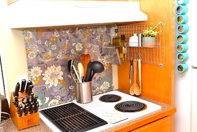 Don't have a back-splash for your stove? Just find a cheap piece of glass and some fabric you love and attach it to the wall with some brackets. Instant cheap and interchangeable decor and no more nasty wall!