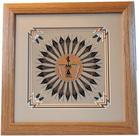 Sand painting called Sun and Eagle, it was created by Navajo artist Diane Thomas from Kirkland, New Mexico. The sand painting is framed in a 14inches x 14inches honey wood frame with triple matting. A photo of the artist is included. Shipping is Free.