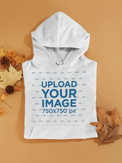 Download Placeit Mockup Of A Folded Hoodie Among Some Autumn Leaves Hoodies Clothing Mockup Mockup Design