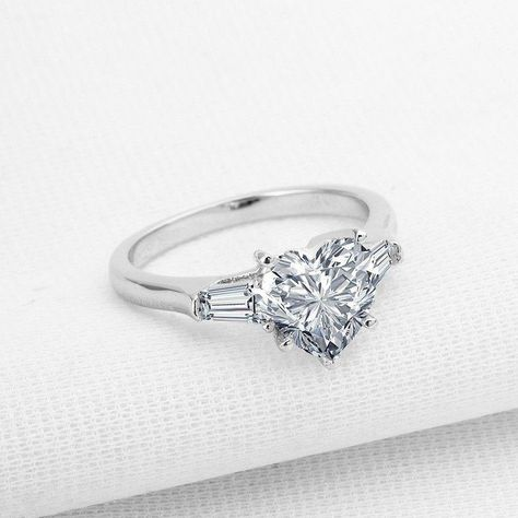 Bring her dreams of a gorgeous proposal to life with this unique 2-carat diamond engagement ring. Crafted in 925 sterling silver with platinum plated, this mesmerizing style features a sparkling 8mm*8mm sona diamond atop the high polished shank. Shimmering with the shine of the diamond and a brilliant buffed luster, this engagement ring is certain to become a treasured keepsake. #womensterlingsilverrings #jewelryrings