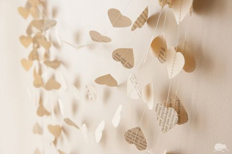 This is also really pretty and might look good for a canopy to get married underneath.    Paper Heart Garland, Recycled Wedding decoration, 20 ft / 6 m, Vintage, Custom. $13.00, via Etsy.